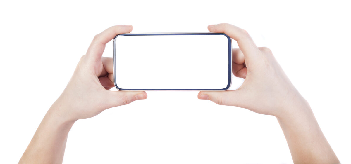 A smartphone in the hands with white screen