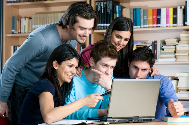 Young people, looking at the laptop screen